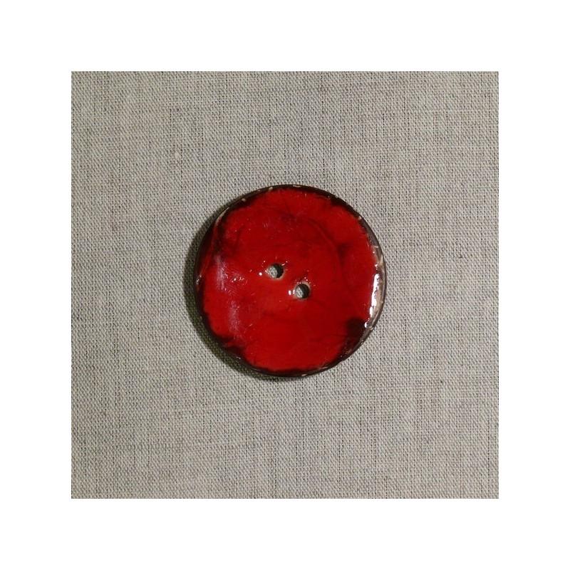 Bouton en noix de coco rouge