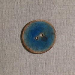 Bouton en noix de coco bleu